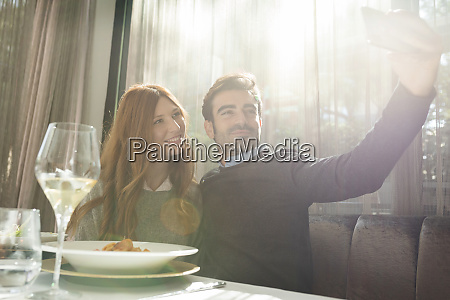 smiling couple taking a selfie in