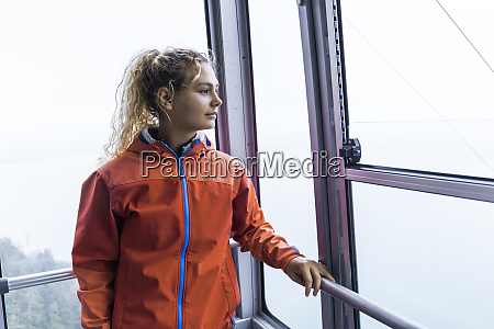 young woman using cable car to