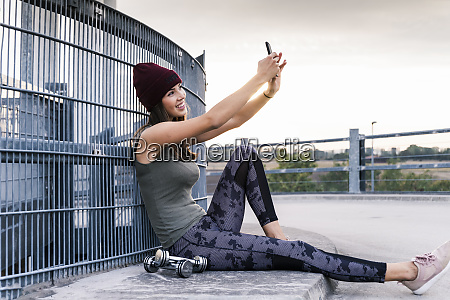 young woman sitting on ground after