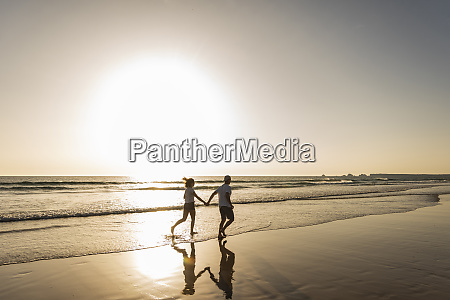 young, couple, doing, a, romantic, beach - 26401687
