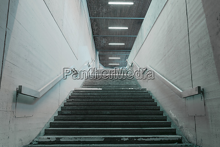 staircase with concrete walls and metal