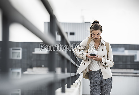 young businesswoman using smartphone in he