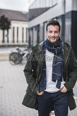 mature man wearing coat and scarf
