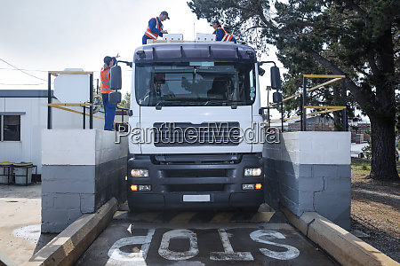 workers in reflective vests loading truck
