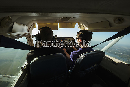 father and son flying small airplane