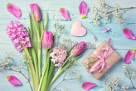 pastel colored flowers and a gift