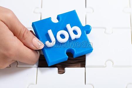 human hand holding job jigsaw puzzle