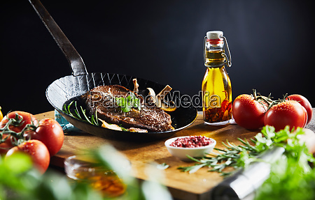 prepared grilled steak with herbs in