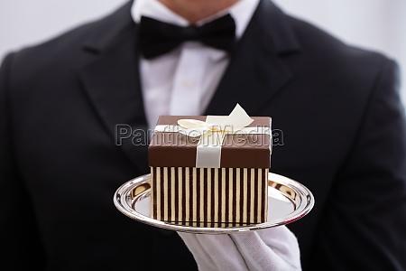 waiter presenting gift box
