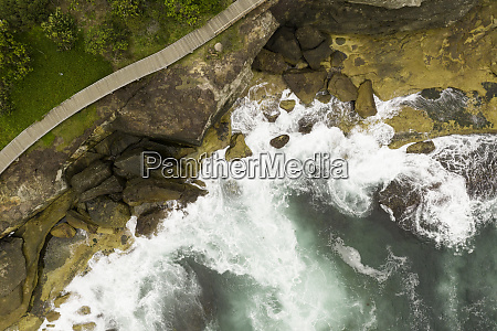 aerial view of ocean rocks and