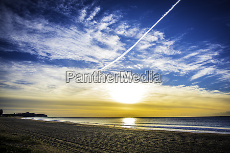 jet stream across a blue sunrise