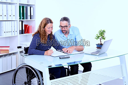 disabled businesswoman in wheelchair and her
