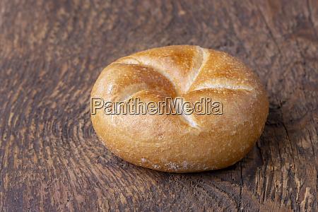 single bavarian bun on wood