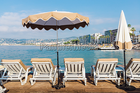 rows of empty beach lounges in