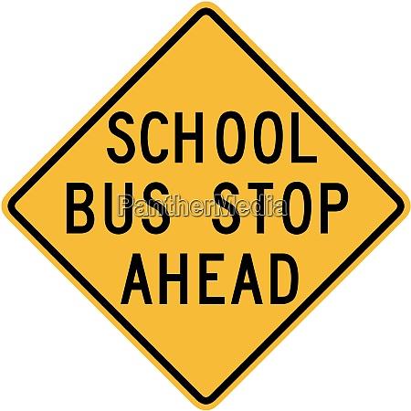 parada de autobus escolar por delante