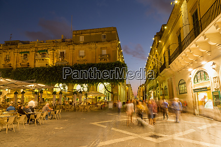 people enjoying an evening at piazza
