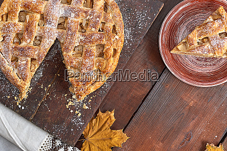 baked round apple pie and one