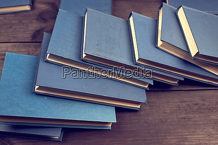 books in a blue cover on