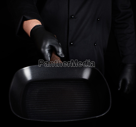 chef in black uniform and black