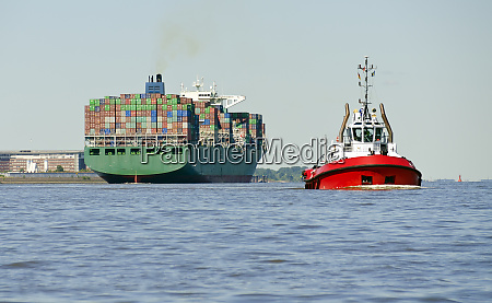 container ship and harbour tow boat