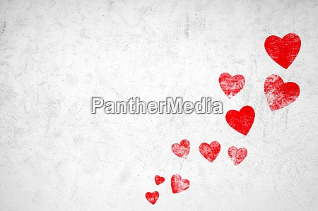 grunge hearts on white wall