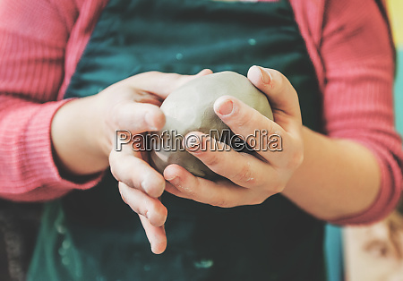 female pottery artist molding clay
