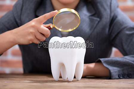 person holding magnifying glass over the