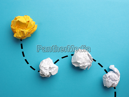 creativity concept with crumpled yellow paper