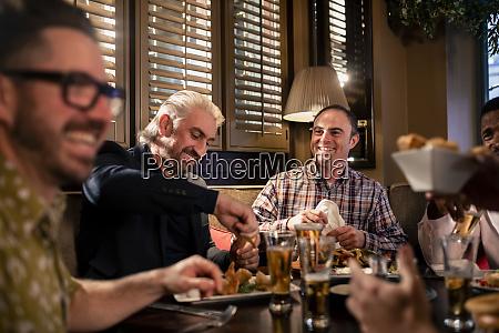 men enjoying food together