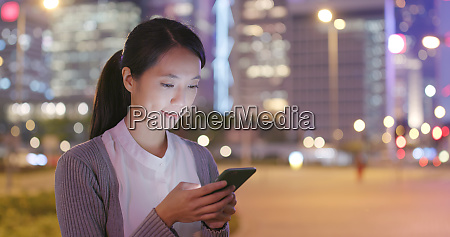 woman sending text message on mobile