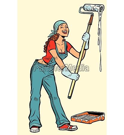 woman painter paints the walls