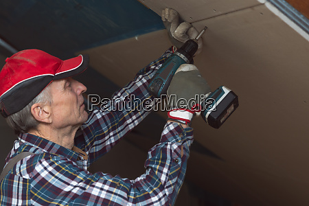 drywall construction attic renovation man fixing