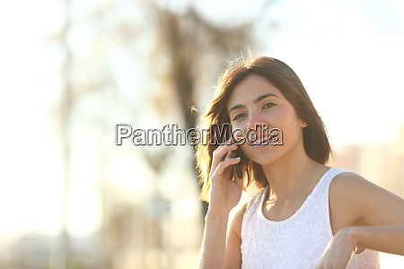 woman is talking on phone outdoors