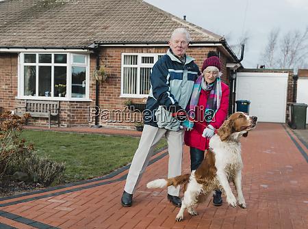 senior couple struggling to walk the