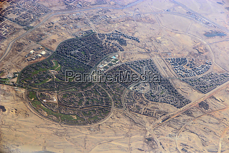 aerial city view with roads houses