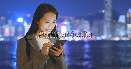 business woman using cellphone in hong