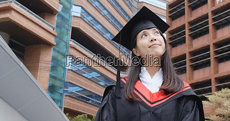 cheerful confident graduation woman look far