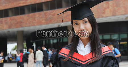 asian woman wearing graduation gown