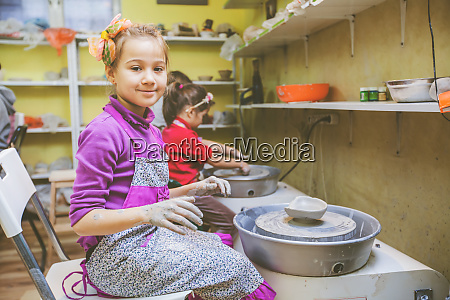 learning new skill at pottery workshop