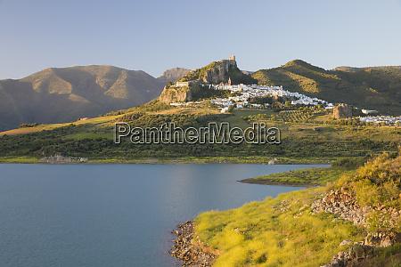 moorish castle above white village and
