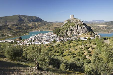 moorish castle above white village with
