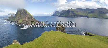 panoramic of drangarnir and tindholmur islet