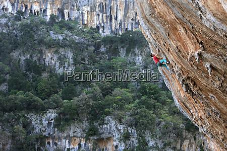 a climber scales cliffs at kyparissi