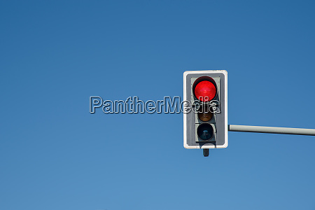 traffic light showing red somewhere in