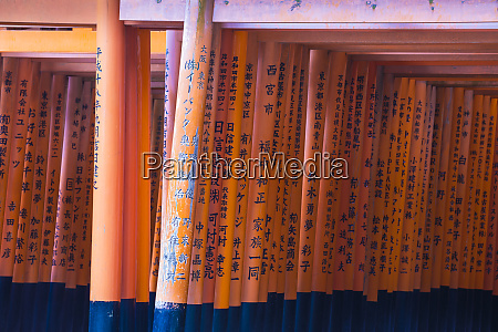 vermilion torii gates donated and inscribed