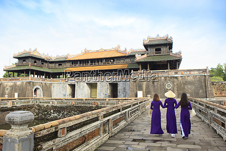 women in traditional ao dai dresses