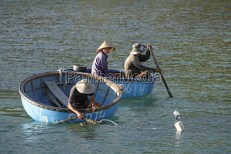 cham island fishermen in traditional coracle
