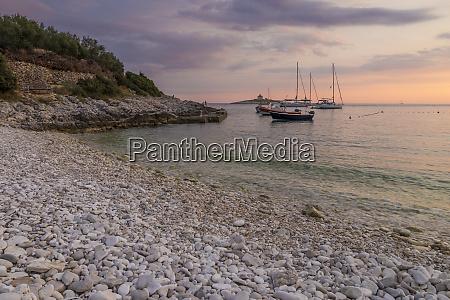 boats anchoring at pokonji dol beach