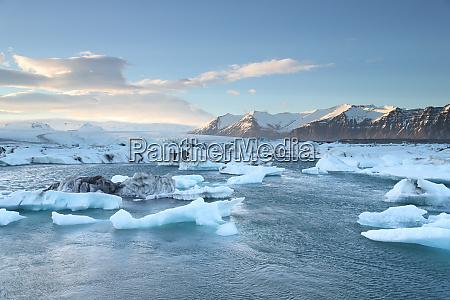 icelandic glacier jokulsarlon with icebergs floating