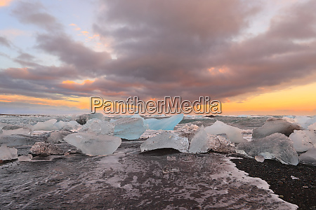 icelandic glacier jokulsarlon with icebergs on